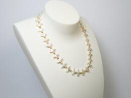 kreuzförmige perlen