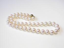 Kette mit runden weißen Perlen  höchster Qualität,9,4-10,4 mm, AAA