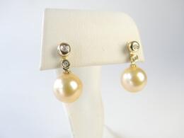 Stecker mit zwei Diamanten und goldener Südseeperle